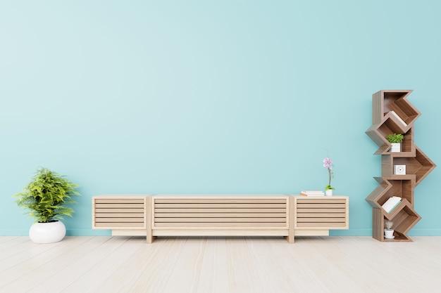 Le salon a des armoires et des étagères avec mur arrière bleu Photo Premium