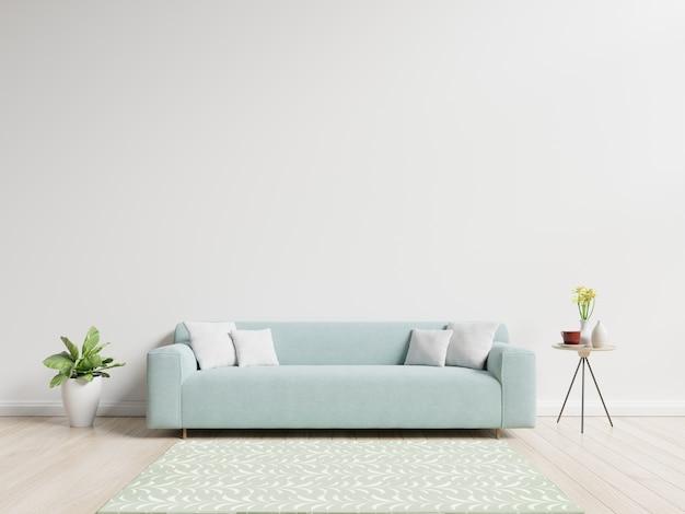 Salon avec canapé ont des oreillers, des plantes et un vase avec des fleurs sur fond de mur blanc Photo Premium