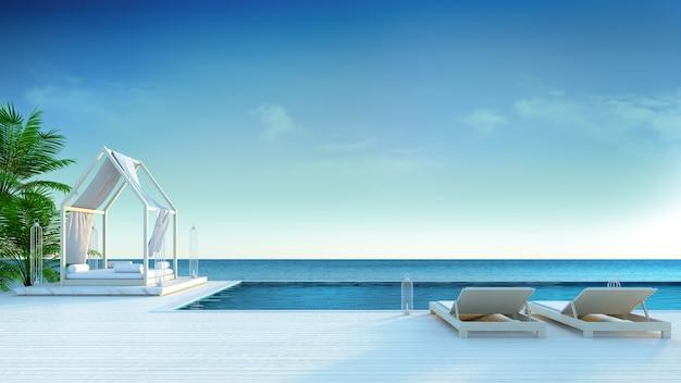 Salon de plage, chaises longues sur le pont de sunbathing et piscine privée à la villa de luxe / 3d Photo Premium