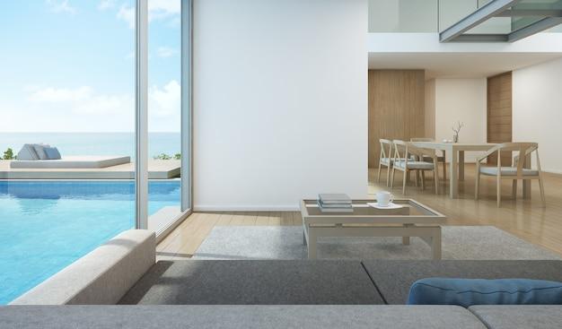 Salon Et Salle à Manger Vue Mer Dans Pool House Moderne. Photo Premium