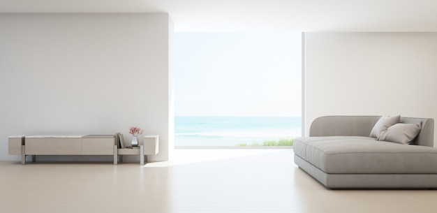 Salon vue mer de la maison de plage d'été de luxe avec meuble tv et meuble en bois. Photo Premium