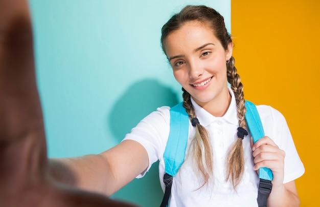 Selfie portrait d'une écolière Photo gratuit