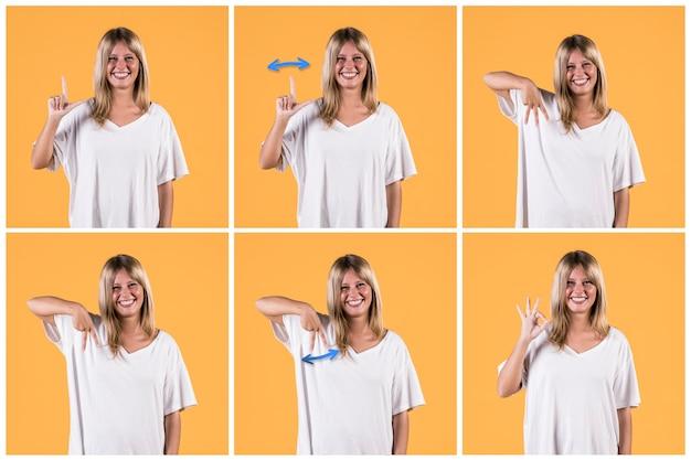 Série de femme montrant des alphabets de signes sourds sur fond jaune Photo gratuit