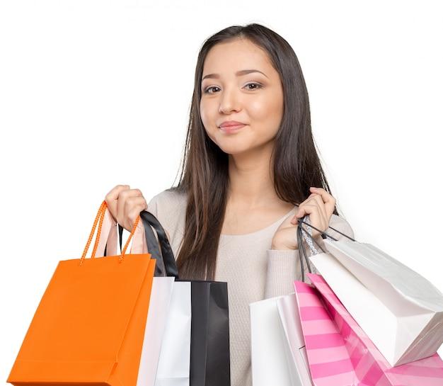 Shopping femme tenant des sacs Photo Premium