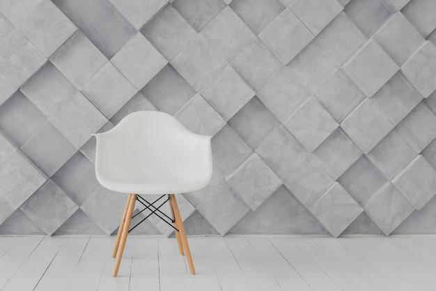 Siège moderne et fond géométrique Photo gratuit