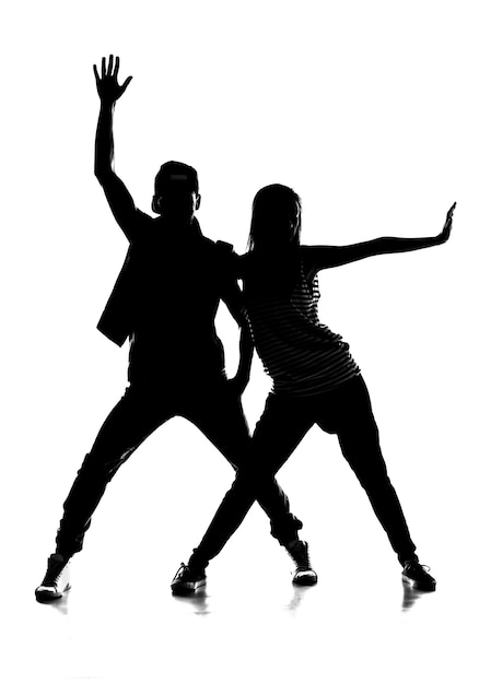 Silhouette de couple dansant le hip-hop. Photo Premium
