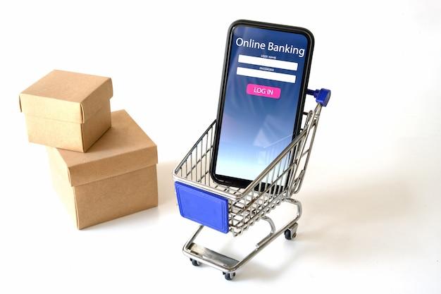 Smartphone montrant l'application de paiement en ligne sur le panier d'achat de la maquette en blanc. Photo Premium