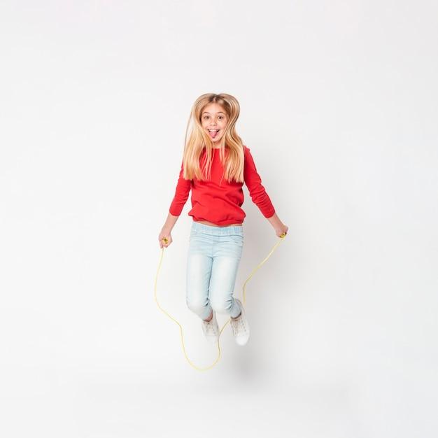 Smiley Girl Jumping Photo Premium