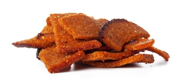 Snack de pain croquant isolé sur blanc Photo Premium