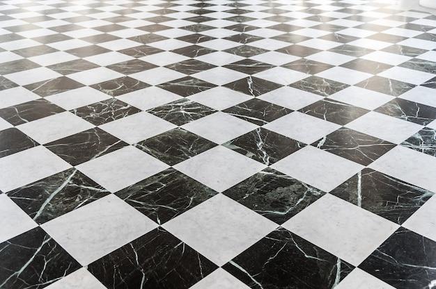 Sol en marbre à damier noir et blanc Photo Premium