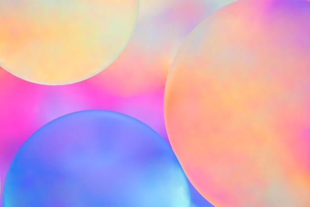 Sphères Multicolores Sur Fond Flou Teinté Photo gratuit