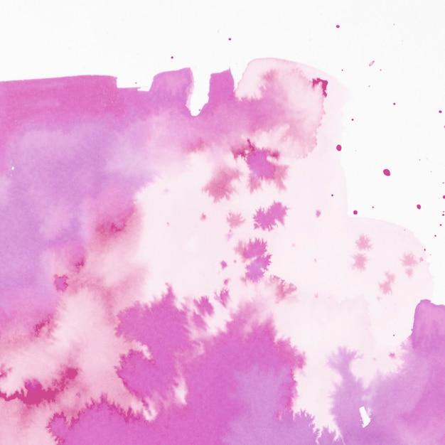 Splash aquarelle rose abstraite sur fond blanc Photo gratuit