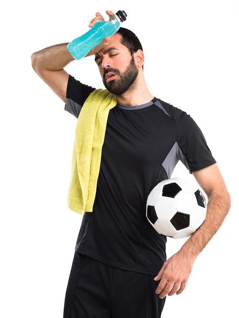 Sport en bouteille blonde blanche football Photo gratuit