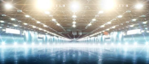 Sport. Patinoire D'hiver à L'honneur. Patinoire Vide Avec De La Glace Et Des Lumières Photo Premium