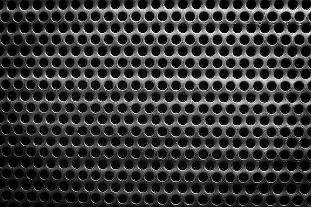 Surface en acier noir et blanc avec petits trous ronds Photo Premium