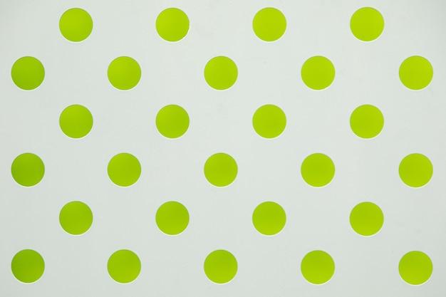 Surface Blanche Avec Grande Impression Verte à Pois Photo Premium