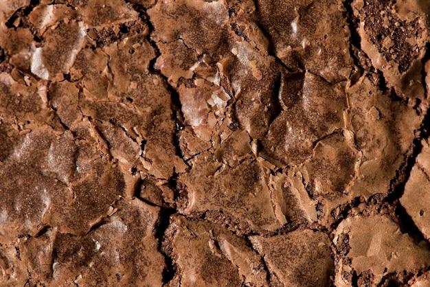 Surface De Brownie Craquelée Cuite Texturée Photo gratuit
