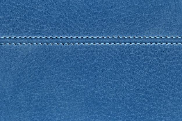 Surface du fond de sac en cuir bleu pour la toile de fond de votre travail. Photo Premium