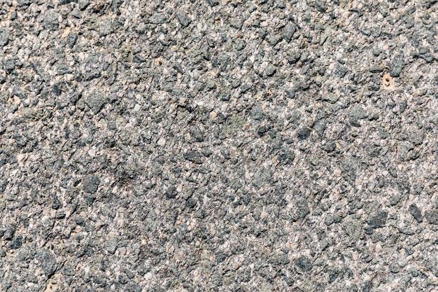 Surface rugueuse d'asphalte Photo gratuit