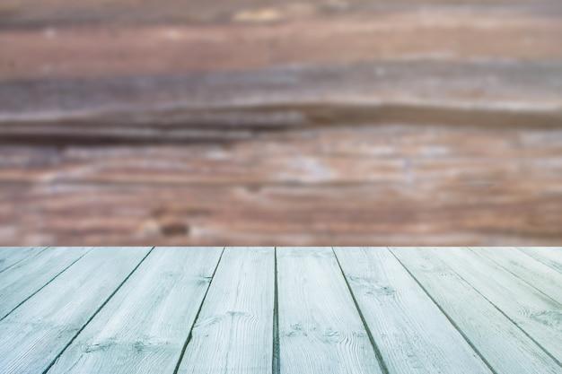 Table bleue sur le bois de texture d'arrière-plan flou Photo Premium