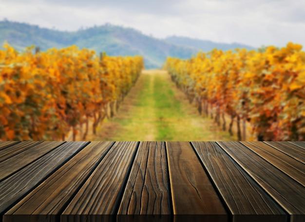 Table en bois dans le paysage de vigne automne. Photo Premium