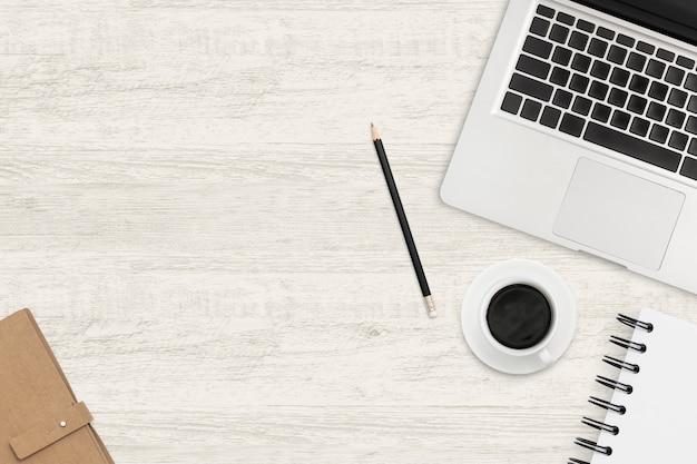 Table de bureau en bois avec ordinateur portable et fournitures de bureau. vue de dessus de l'espace de travail. Photo Premium