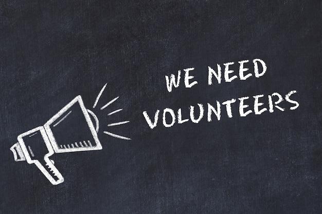 Tableau de craie avec haut-parleur et phrase nous avons besoin de volontaires Photo Premium