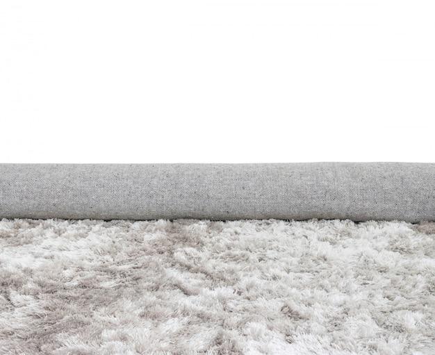 Tapis de tissu gris de rouleau de surface agrandi isolé sur blanc Photo Premium