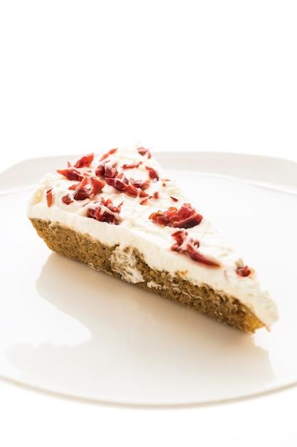 Tarte aux canneberges ou un gâteau dans une assiette blanche Photo gratuit