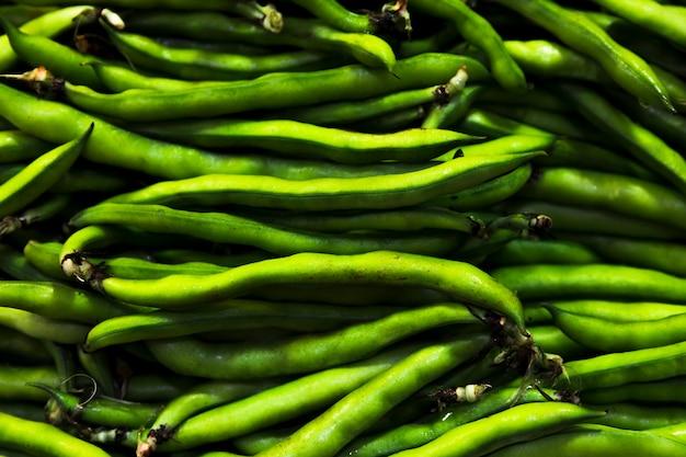 Tas de haricots verts vue de dessus Photo gratuit