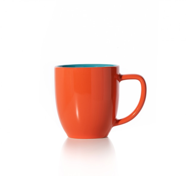 Tasse Orange Sur Fond Blanc Photo Premium