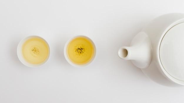 Tasse de thé vue de dessus avec théière Photo gratuit