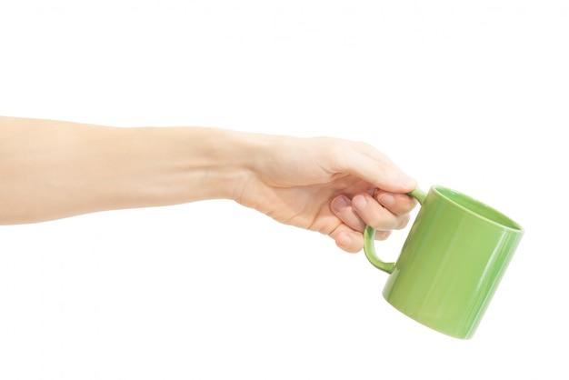 Une tasse verte en main isolée Photo Premium