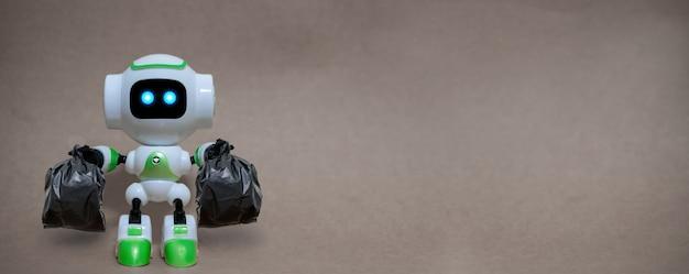 La technologie des sacs à ordures robotiques tient l'environnement de recyclage sur un fond gris Photo Premium