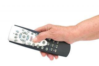 Télécommande à la main isolée, de divertissement Photo gratuit