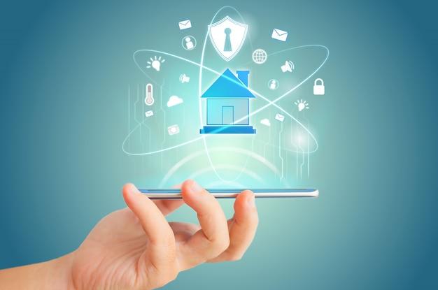 Téléphone intelligent à distance pour l'idée de concept de technologie maison intelligente hologramme. Photo Premium