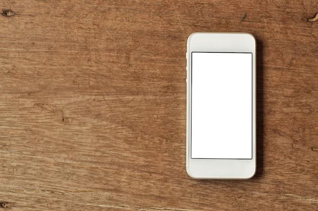 Téléphone portable sur fond de bois Photo Premium