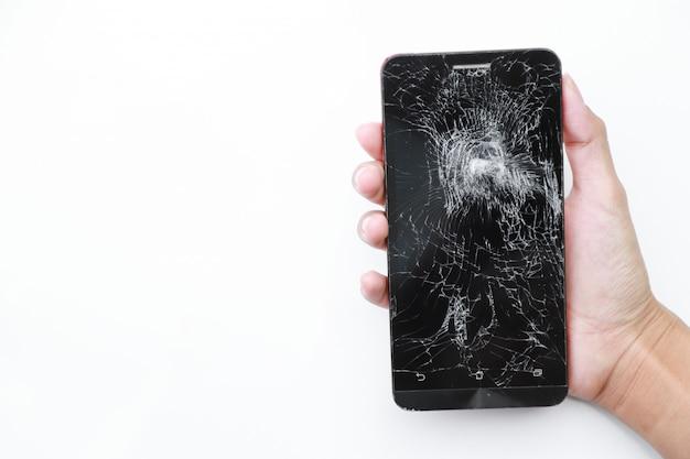 Téléphone S'est écrasé Sur Blanc Photo Premium