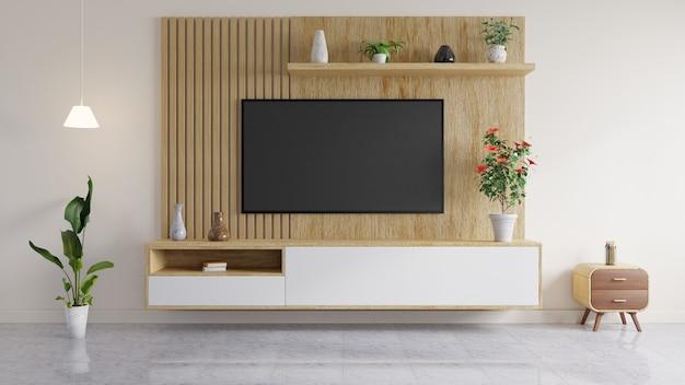La Télévision Est Montée Sur Un Mur En Bois, Avec Un Vase Et Des Livres Sur L'étagère, Un Pot De Fleurs Et Une Table D'appoint Dans Le Salon. Photo Premium