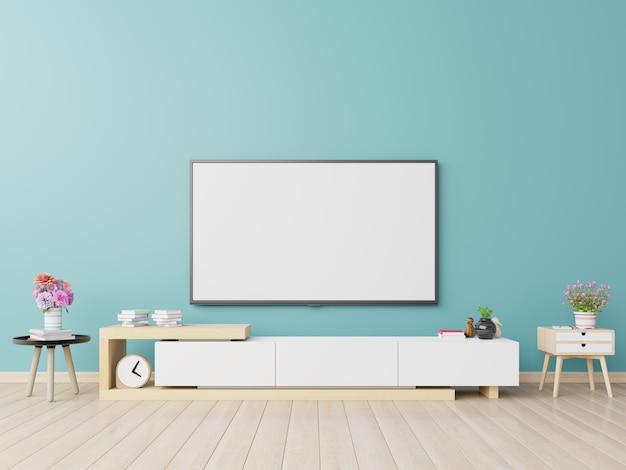 La Télévision Sur Le Meuble Du Salon Moderne Contient Des Plantes Et Un Livre Sur Un Fond De Mur Bleu. Photo Premium