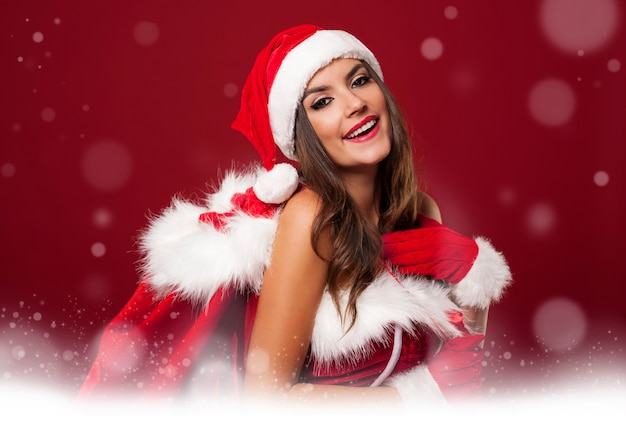 Temps Magique Avec Une Femme Sexy De Santa Photo gratuit