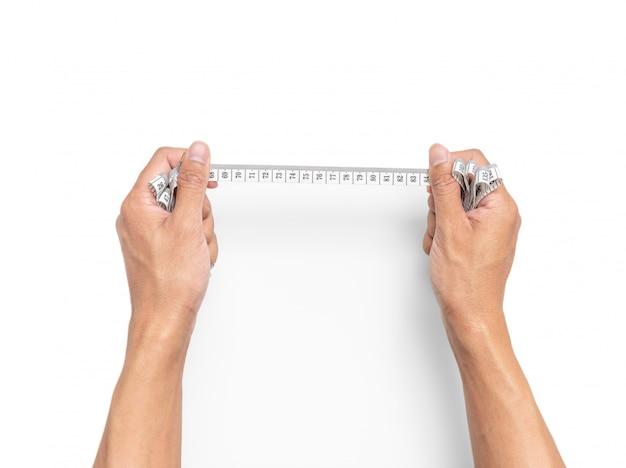 Tenir La Main Ruban à Mesurer Sur Fond Blanc Isolé Photo Premium