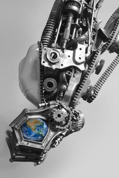 La terre dans la main du robot Photo Premium