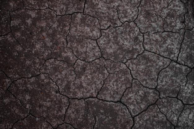 Terre sèche ou sol sec. fond de sol fissuré. Photo Premium