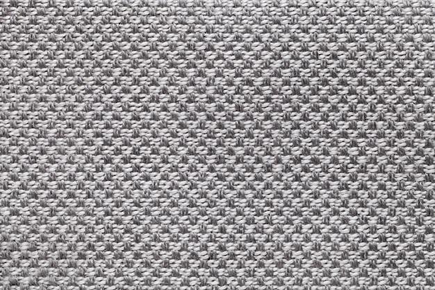 Textile gris clair avec damier, gros plan. structure de la macro de tissu. Photo Premium