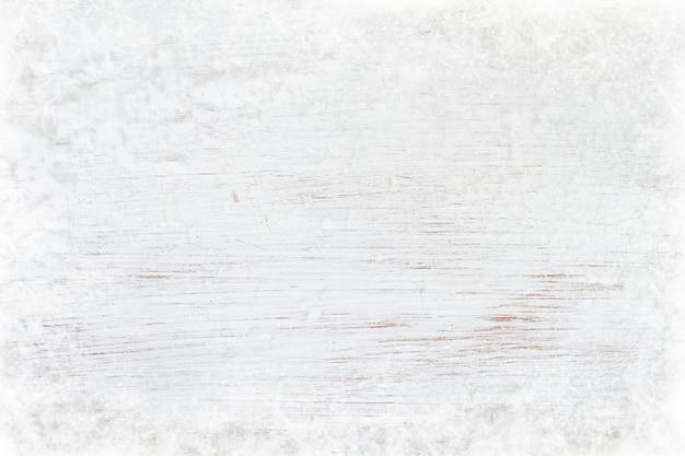 Texture bois ancienne blanche avec de la neige. vue de dessus, conception de la frontière. Photo Premium
