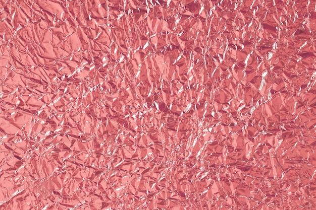 Texture brillante feuille d'or rose, papier d'emballage rouge abstrait Photo Premium