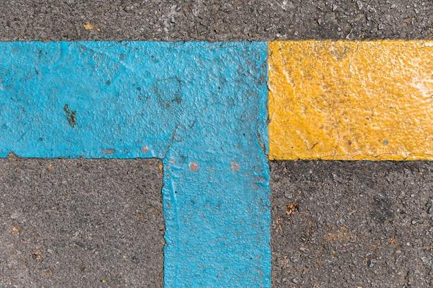Texture de la chaussée avec des feux de circulation Photo gratuit