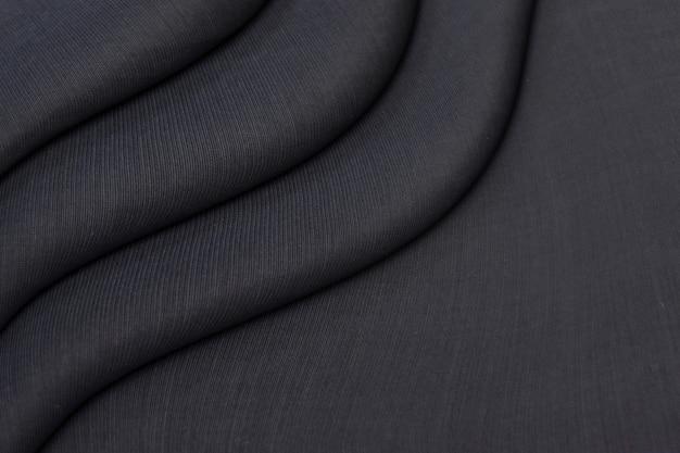 Texture De Draperie En Tricot Noir Froissé Photo Premium