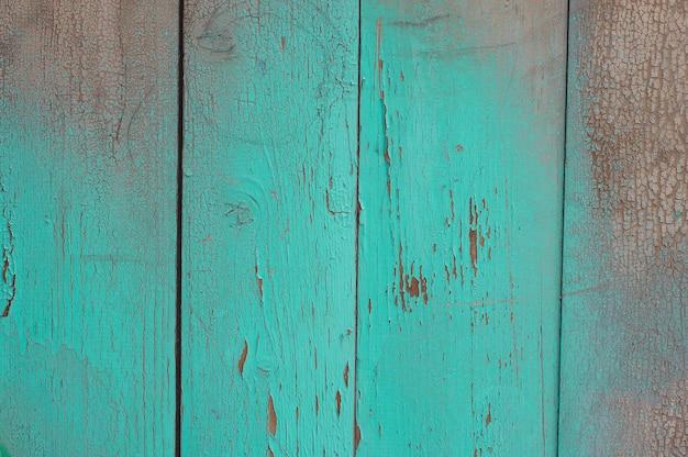 Texture du bois vert avec des fissures sur la peinture et des abrasions Photo Premium